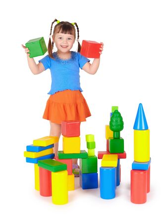 The little girl is playing with colored blocks Stock Photo - 6547258