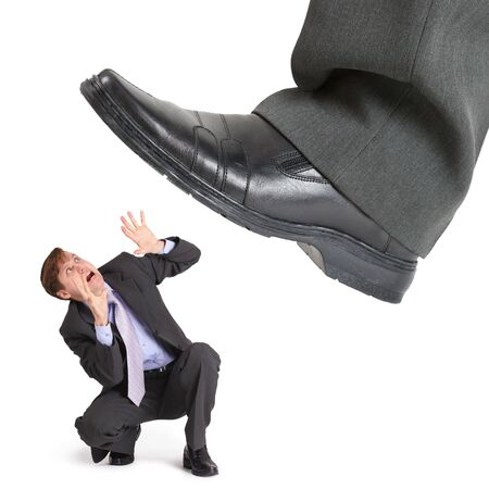 trample: Big foot of crisis crushes small entrepreneur isolated on white Stock Photo