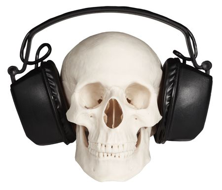 The human skull with music headphones on a white background Stock Photo - 6574546