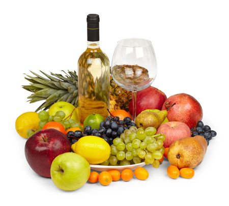Still Life from a heap of fruits and bottle of white wine isolated on white background photo