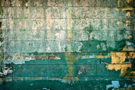 The surface is covered by old rotting, peeling boards Stock Photo - 6619774