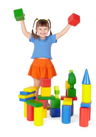 Joyful child plays in the builder isolated on a white background photo