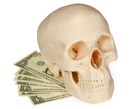 The human skull lying on a pack of money isolated on a white background Stock Photo - 6619773
