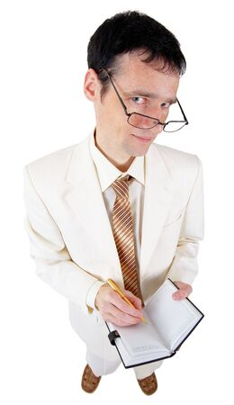 Funny young business man with a notebook on a white background Stock Photo - 6626101