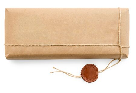 Postal parcel wrapped in coarse paper, isolated on a white background photo