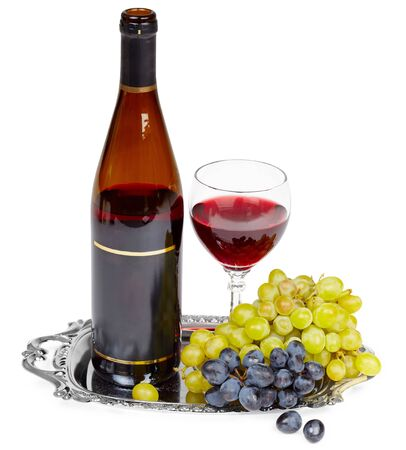 vegetable tray: Beautiful still life - a bottle of wine, glass and grapes on a metal tray Stock Photo