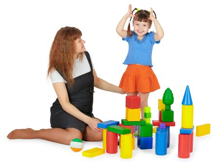 Mother and daughter playing with colored blocks on a white background photo