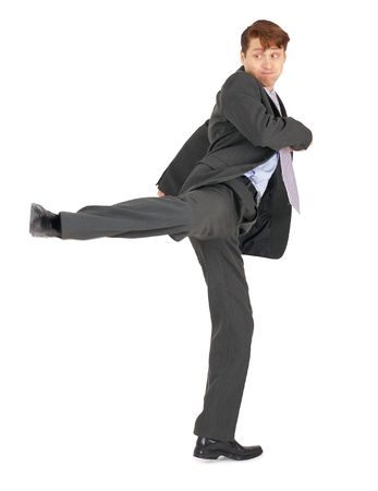 Businessman showing a karate kick, isolated on a white background Stock Photo - 6682766