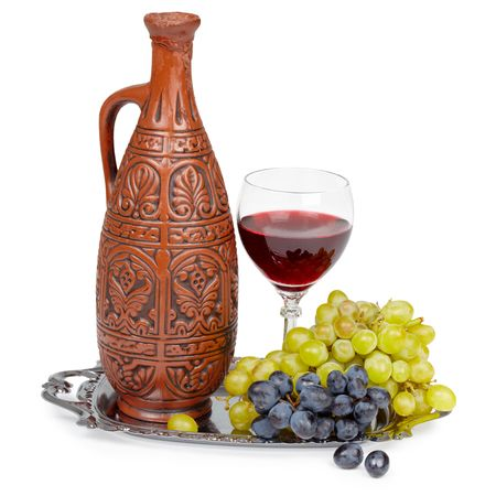 Still life - a clay jug and a glass of red wine grape Stock Photo - 6709558