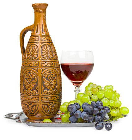 Still life - a clay jug, a glass of wine and grapes isolated on white Stock Photo - 6759812