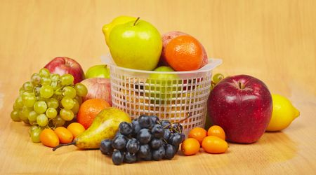 Large still life of different fruits on a wooden background photo