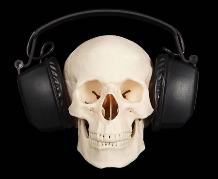 The human skull with stereo headphones on a black background Stock Photo - 6781408