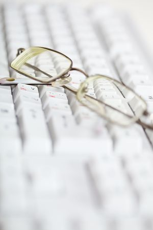 poor eyesight: Spectacles are on the computer keyboard - poor eyesight