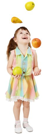 A little funny girl juggles fruit on white background photo