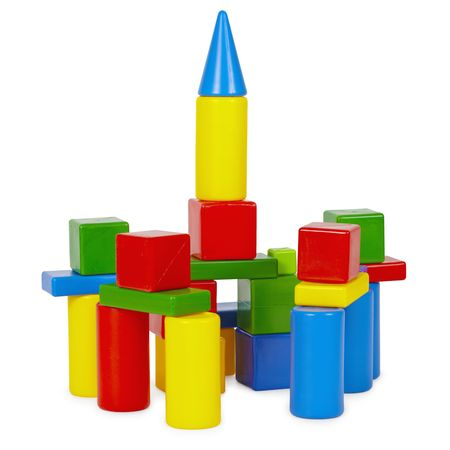 Tower of toy bricks on a white background photo