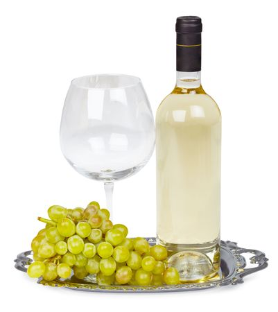 A bottle of white wine, glass and grapes on a metal tray photo