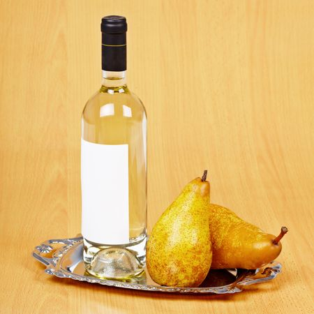 spirituous beverages: Still life from a bottle of pear wine on the table