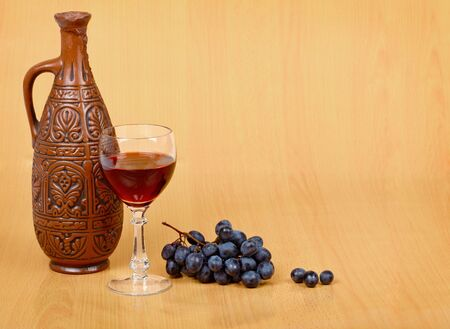 Artistic composition of the crock, glass and grapes Stock Photo - 6828863