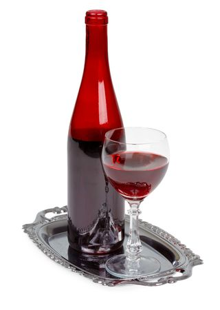 spirituous beverages: Red wine bottle and glass on a metal tray Stock Photo