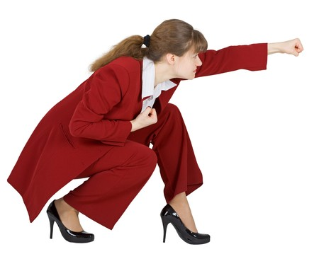Businesswoman sits in a combat position on a white background photo