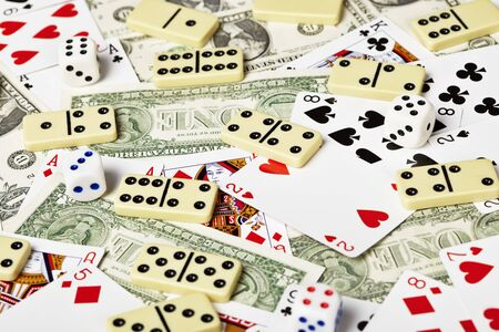 Playing cards, money, dominoes and dices
