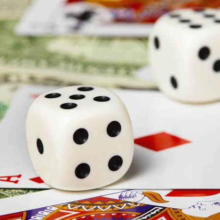 Dice against the cards and money close-up photo