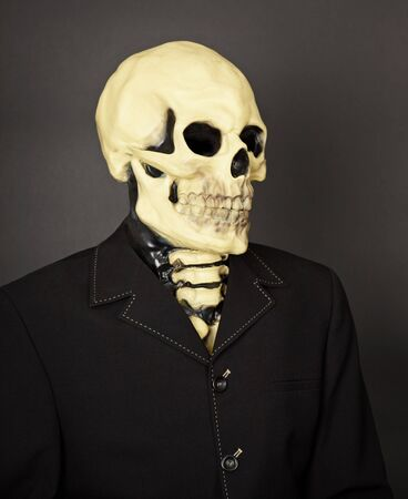 Portrait of death in a business suit on a dark background Stock Photo - 6949882