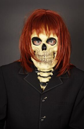 bared teeth: Funny man in a mask - a skull and a wig