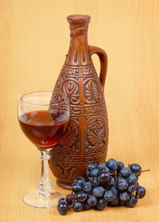 spirituous beverages: Still Life - ceramic jug and a glass of wine