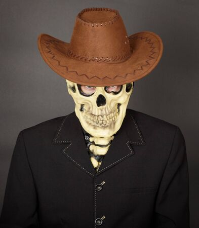 bared teeth: The man - a skeleton in a leather cowboy hat