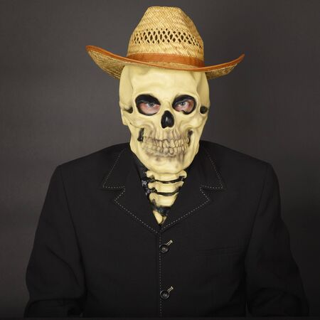 Skeleton in a straw hat on a dark background Stock Photo - 6949934