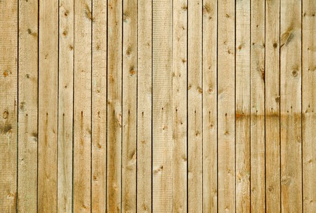 Wall covered with rough pine boards - a wooden background photo