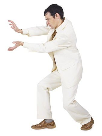 exorcism: The amusing businessman pushes something forward on white Stock Photo