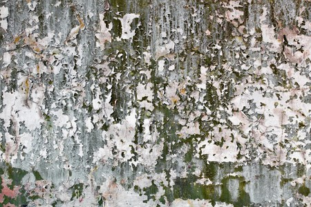 Tatter of a multi-colored old paint on a surface of a concrete wall Stock Photo - 7031609