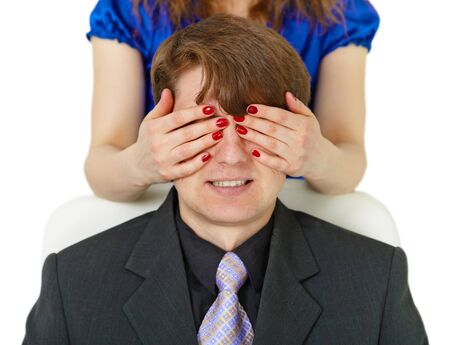 smiled: The woman has closed to the young man of an eye by means of hands