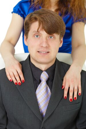 smiled: Female hands on the shoulders of young men