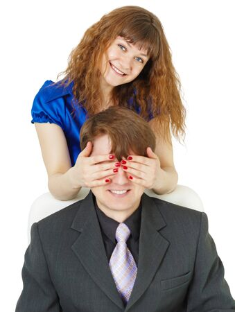 Playful woman covered eyes with a young man photo