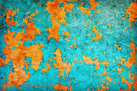 peeling paint: Abstract texture - a wall covered with the peeled paint of dark blue and orange color