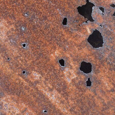 oxidated: Hoja de hierro con agujeros generados por corrosi�n  Foto de archivo