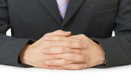 Mens hands are on the surface of the white table photo