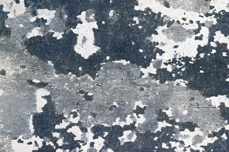 The surface of the wall with cracks and pieces of old paint Stock Photo - 7300624