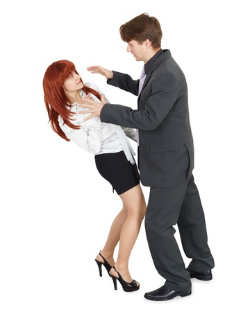 A young man attacks a woman, isolated on a white background photo