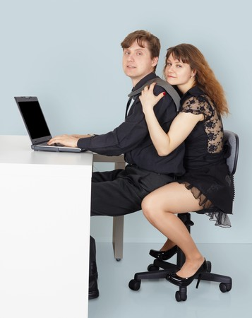 Husband and wife go to surf the Internet using a laptop photo