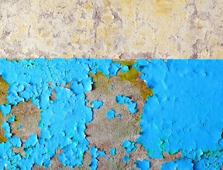 The damaged wall of the ruined building painted in two different colors Stock Photo - 7313342