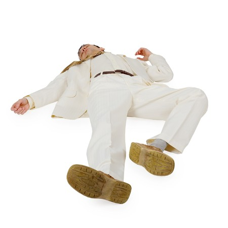 defeated: Defeated Businessman lying on a white background