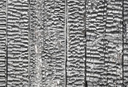 charred: Charred surface of the wooden wall - background Stock Photo