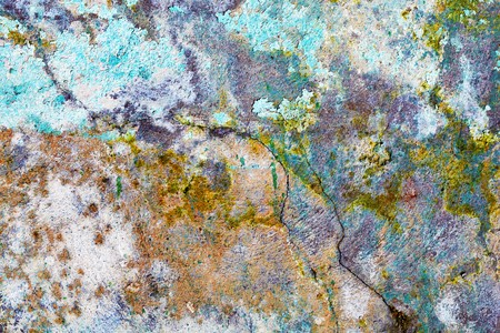 mustiness: Rough dirty stone wall with color pattern Stock Photo