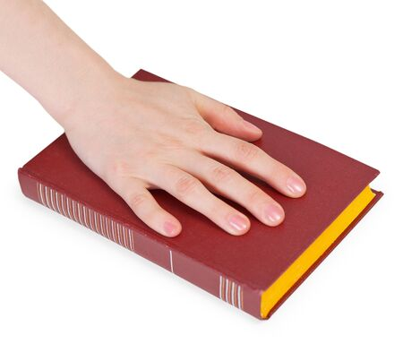 oath: Hand of the person reciting the oath on the book isolated on a white background