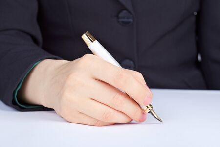 The person undersigns an golden ink pen photo