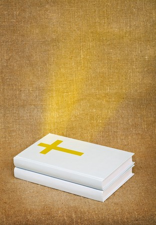 sacred source: The bible - a source of sacred knowledge, is shone by gold beams